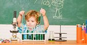 Study Grants And Scholarship. Boy Performing Chemistry Test. Wunderkind And Early Development. Small poster