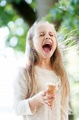 Ice Cream Makes Her Fall Into Euphoria. Cute Little Girl Eating Ice Cream On Summer Day. Small Child poster
