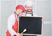 Mastering Cooking Skills. Couple Of Man And Woman Holding Empty Blackboard In Cooking School. Master poster