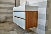Bathroom Console Sink Vanity In Luxury Bathroom With Teak Floor. Stylish Interior Of Modern Bathroom poster