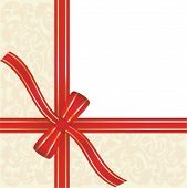 picture of gift wrapped  - red gift ribbon wrapped around decorative background with copy space - JPG