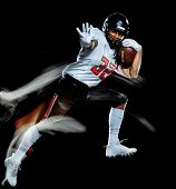 one african american football player man studio shot isolated on black background with light paintin poster