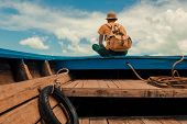 Young Adventurers With Backpack Sitting On A Traveling Boat And Looking To The Destination There Is  poster