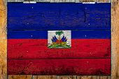 National Flag Of Haiti On A Wooden Wall Background.the Concept Of National Pride And Symbol Of The C poster