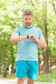 Useful Settings. Wrist Band Gadget. Athlete Check Fitness Tracker Nature Background. Athlete Look Pe poster