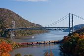 foto of bear tracks  - The Bear Mountain Bridge and a freight train traveling down the Hudson River - JPG