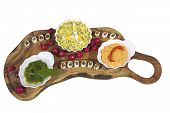 Delicius organic food on olive tree plate