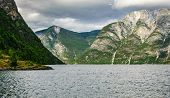 Scenic View Of The Fjord And Rocks .scenic View, The Sun Illuminates The Mountains And Fjords. poster