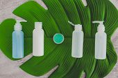 Organic Lotions And Skincare Products With Tropical Flowers And Leaf In Spa Setting poster