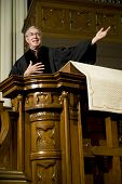 stock photo of preacher  - Preacher giving a sermon from the pulpit - JPG