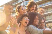 Joyful Multiethnic Friends Taking Funny Group Selfie Outside. Mix Raced Men And Women Posing, Grimac poster