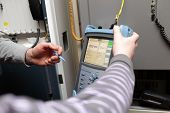 Maintenance Technicians With Reflectometer