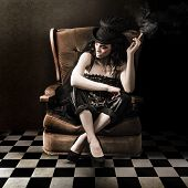 picture of mad hatter  - Fine Art Photo Of A Young Fashion Lady Sitting On Vintage Sofa In Grunge Interior - JPG