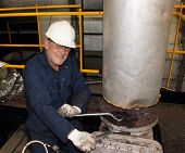 An engineer working on a steam valve