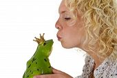 Young Woman Kissing A Frog Prince
