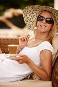 Atrractive Woman Enjpying Coffee On A Vacation