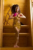 stock photo of indium  - girl dancing indian dance upstairs in wooden house - JPG