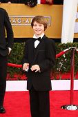 LOS ANGELES - JAN 27:  Daniel Huttlestone arrives at the 2013 Screen Actor's Guild Awards at the Shr
