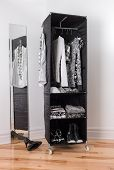 Clothes Organizer With Black And White Clothing