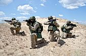 picture of battlefield  - Squad of soldiers in the desert during the military operation - JPG