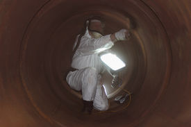 pic of ppe  - An engineer wearing  correct ppe for an industrial boiler clean inside the furnance - JPG