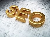 SEO web development concept: Golden SEO on digital background