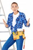 DIY handy woman at her wits end raising her palms in the air to indicate that she does know the answ