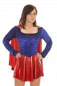 foto of short-story  - A woman in her super hero costume with her hands on her hips - JPG