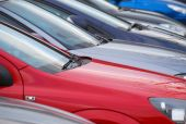 stock photo of polution  - Telephoto view of cars parked in car park - JPG