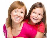 stock photo of piggyback ride  - Portrait of a happy daughter piggyback ride her mother - JPG