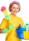 Young woman as a cleaning maid holding bucket full of liquids and static duster, isolated over white