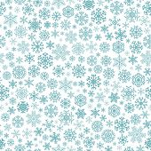 stock photo of pale  - Christmas seamless pattern from turquoise snowflakes on white background - JPG