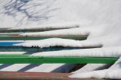 Five Benches Covered With Snow