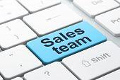 Marketing concept: Sales Team on computer keyboard background