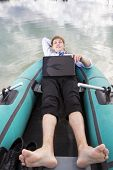 Dressed Man Lay In Boat