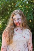 MUSKOGEE, OK - Sept. 14: Actors costumed as bloody zombies wait for the athletes during the Castle Z