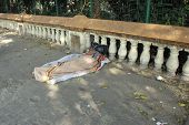 KOLKATA - NOVEMBER 25: Homeless people sleeping on the footpath of Kolkata. on November 25, 2012 in Kolkata, India.