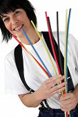 Woman holding pipe cleaners