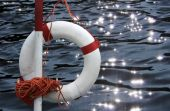 Life Buoy In Front Of Glittering Water