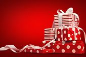 image of christmas greetings  - Christmas gifts with ribbon on a red background - JPG