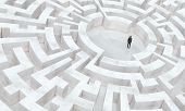 pic of maze  - businessman in the middle of a labyrinth - JPG