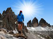 Girl looking at the Tre cime di Lavaredo , Dolomite Alps, Italy