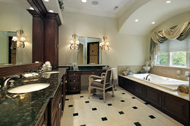 stock photo of light fixture  - Master bath in luxury home with large tub - JPG