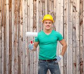 repair, construction and maintenance concept - smiling male manual worker in protective helmet with