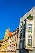 stock photo of tenement  - Facades of ancient tenements in the Main Market of Gliwice - JPG