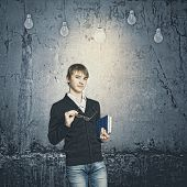 School boy and electric bulbs hanging above