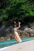 Sexy Slim Woman Posing At The Beach