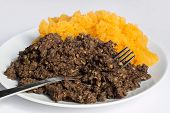 stock photo of haggis  - Traditional haggis and neeps close up also called a burns supper in Scotland - JPG