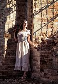Dramatic Portrait Of Beautiful Young Girl In White Dress