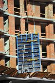 foto of formwork  - Crane with concrete formwork at construction site - JPG